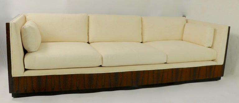 Chic architectural case, or box, sofa designed by Milo Baughman for Thayer Coggin. Nice large full size example having vibrant rosewood veneer case and original off white fabric. This example is selling in original, untouched condition, it shows
