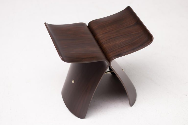 A perfect fusion of western function and eastern or Asian sensibility, the iconic butterfly stool was originally conceived in 1954 by Japanese designer Sori Yanagi. The stool is made from two curving and inverted L-shaped rosewood sections, each