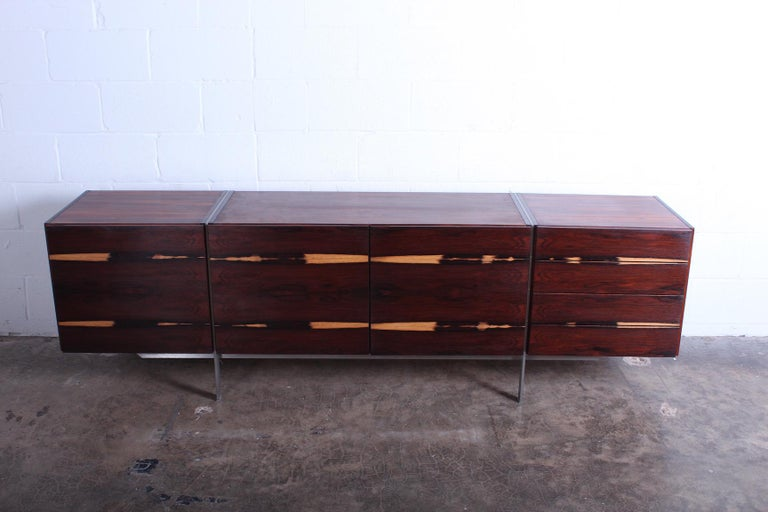 A rare rosewood cabinet with expressive sap grain and brushed steel frame.