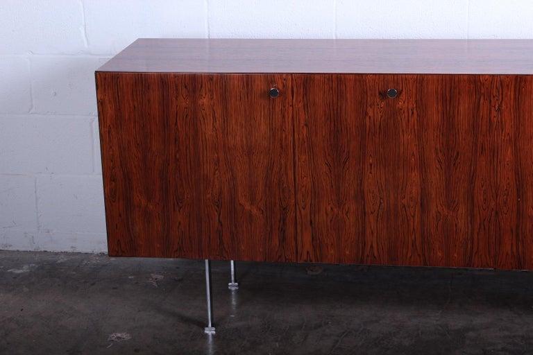 Rosewood cabinet with chrome hardware. Designed by Poul Nørreklit for Georg Petersens Møbelfabrik, 1965.