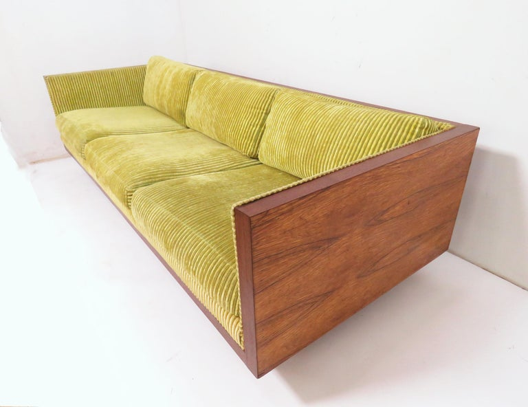 Tuxedo style three-seat sofa in a rosewood cased frame, in the manner of Milo Baughman, circa 1970s. By Charlton Furniture, USA, imported from Israel.