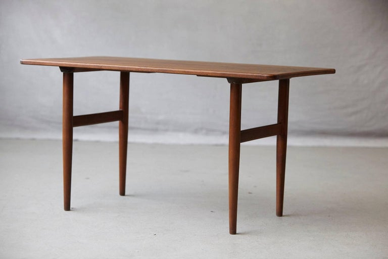 Beautiful rosewood side or small coffee table designed by Kurt Østervig for Jason Møbler Danmark, circa 1960s.  Stamped on the underside Jason Denmark. Slightly sculpted top with rounded corners which gives the table a very soft and harmonious