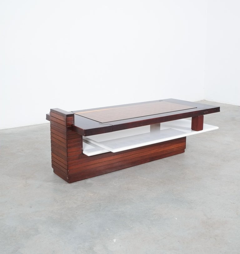 Bespoke solid wood and rosewood and marble coffee table, Brazil, 1970  One of a kind very heavy table made from a solid rosewood tray with an inlaying orange glass top and a solid underlaying marble tray. Unusual design executed with great