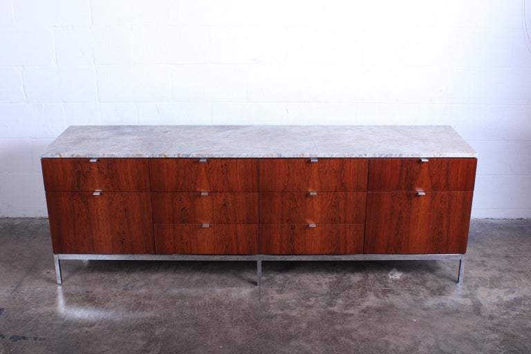 Florence Knoll rosewood credenza with chrome base and stone top.