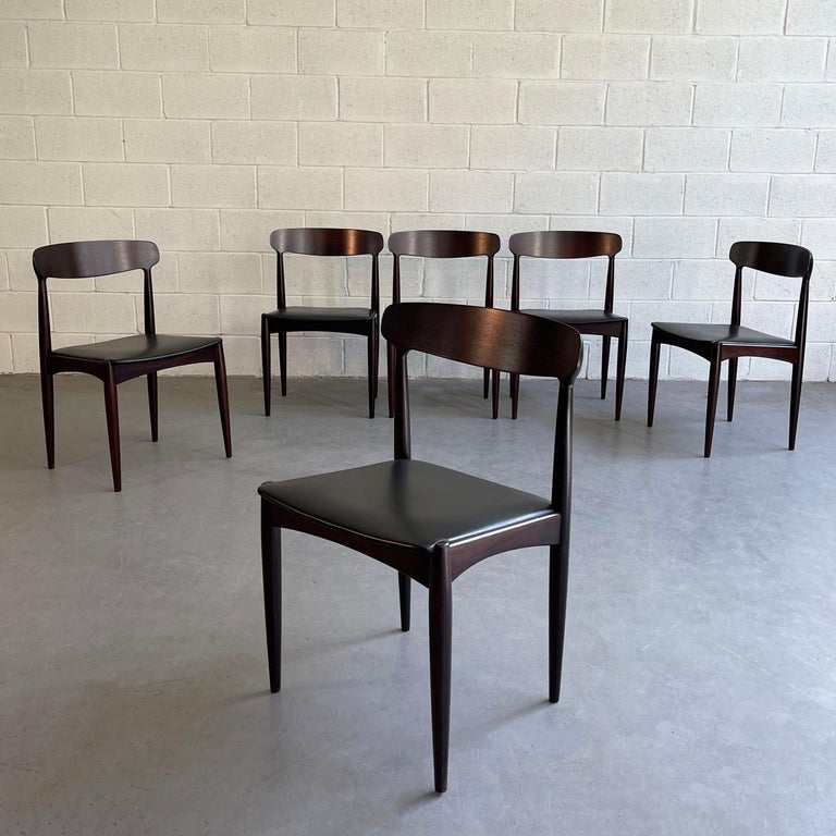 Set of 6, Danish modern dining chairs by Johannes Andersen for Uldum Møbelfabrik feature rosewood frames with black leather seats.