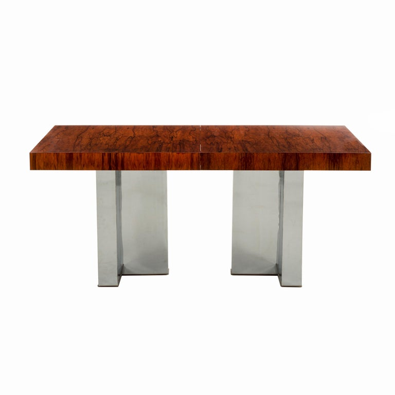 Milo Baughman for Thayer Coggin; exotic bookmatched cathedral patterned rosewood top with T- patterned chrome legs. Two leaves the table extends to 98