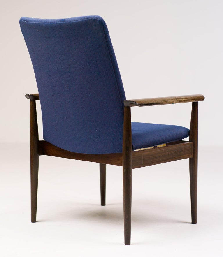 Diplomat chair in rosewood designed by Finn Juhl and manufactured by Cado. Fair original vintage condition. Marked with silver Finn Juhl label.