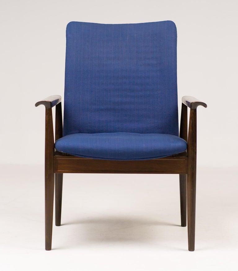 Scandinavian Modern Rosewood Diplomat Chair by Finn Juhl For Sale