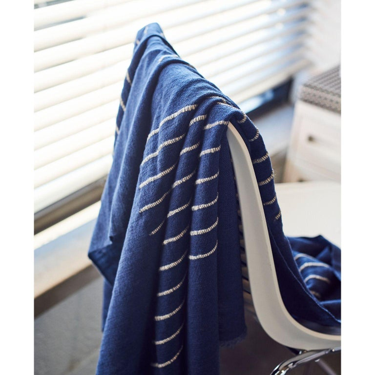 Custom design by Studio Variously, ROSEWOOD INDIGO merino throw / bedspread / blanket is hand-woven by master weavers in Nepal and dyed entirely with eco-friendly dyes.   A sustainable design brand based out of Michigan, Studio Variously exclusively