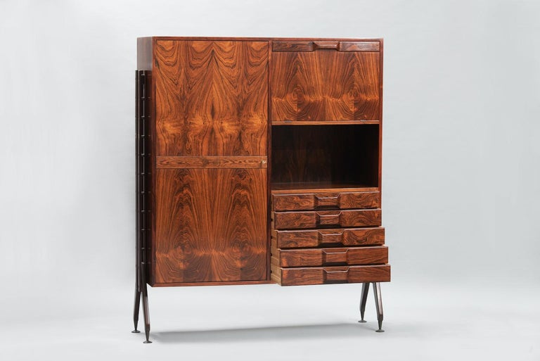 Rosewood Italian cabinet with dry bar, five drawers and shelves in the style of Franco Albini.