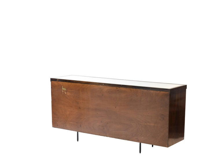 Midcentury brazilian Rosewood Laminate Buffet attributed to Geraldo de Barros, 1960s  This spacious buffet is laminated in rosewood on its two sides and front. Contains six drawers, one with lock and one compartment with doors that can also be
