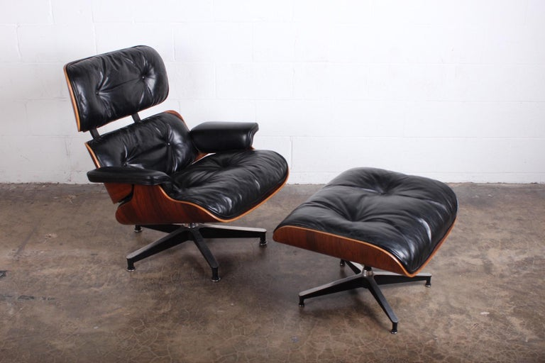 A rosewood 670/671 lounge chair and ottoman by Charles Eames for Herman Miller. Beautiful early example with warm patina.