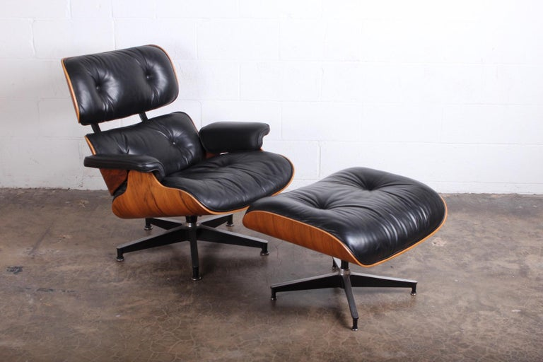 A rosewood 670/671 lounge chair and ottoman by Charles Eames for Herman Miller.