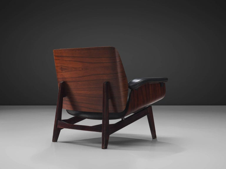 MIM Roma, rosewood, black faux leather, Italy, 1960s.   Armchair with rosewood frame and orange fabric upholstery. Signature chair by MIM Roma. The seating and back are nicely curved and mirrored to each other. Nicely designed legs with folded