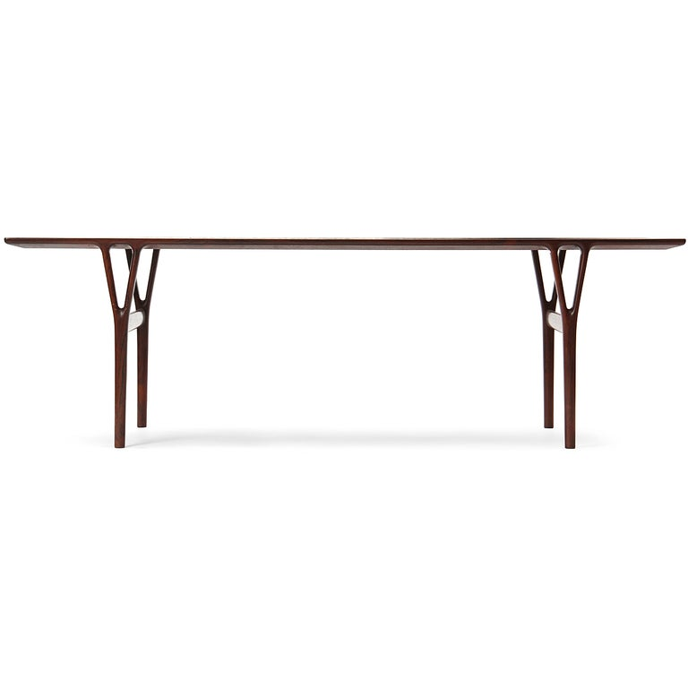 A beautifully constructed Scandinavian Modern narrow low table by renowned Danish designer Helge Vestergaard Jensen. The elegant design in solid rosewood features a bevel-edged top on sculptural Y-form legs. Crafted and impeccably finished by
