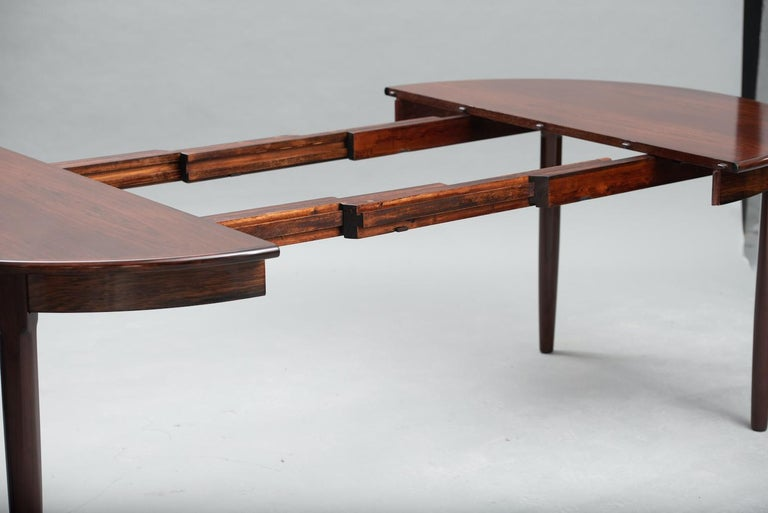 Rosewood Mid-Century Modern Danish extendable round dining table.