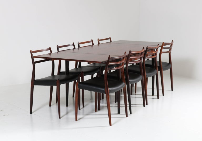 Wonderful and rare Mid-Century Modern dining room set. Design by Niels O. Møller for J.L. Møllers Møbelfabrik. Iconic Danish design from the 1950s. The table has solid rosewood legs and rosewood veneered top. The eight chairs are solid rosewood