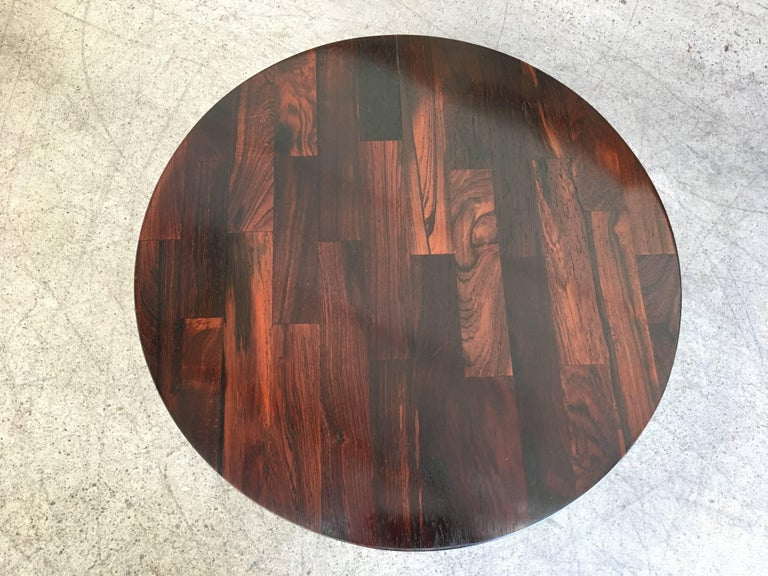 This is solid rosewood strips that were assembled into a round top for the chrome X-base.