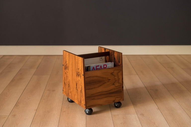 Mid-Century Modern magazine LP record storage cart designed by Rolf Hesland for Bruksbo, Norway. This piece features stunning Brazilian rosewood grains that showcase from any angle. Equipped with two removable dividers and four casters that roll
