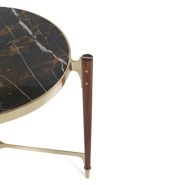 A stunning piece of functional decor, this elegant side table can be displayed alone or combined with the other different pieces by the same designer for a dynamic effect. The unique silhouette of this table, its masterful craftsmanship, and the use