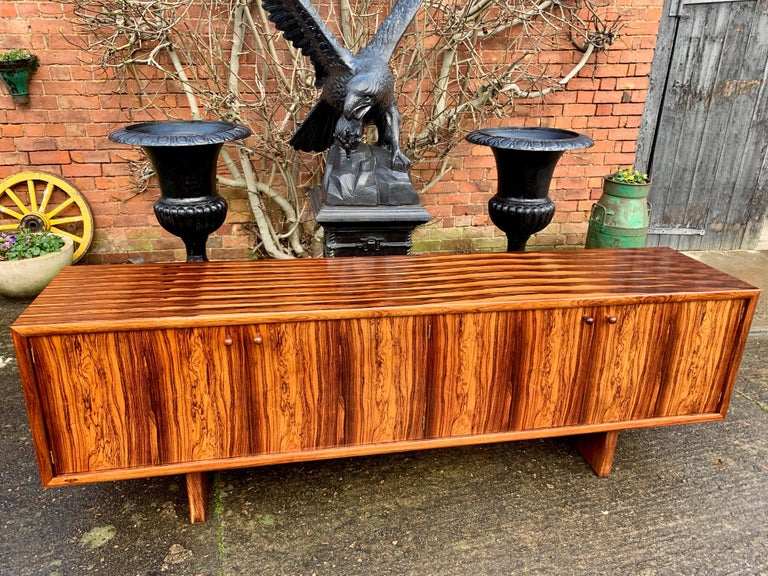 Gordon Russell 'Marlow' rosewood sideboard credenza designed by Martin Hall for Gordon Russell Ltd of Broadway, Material: Figured rosewood - Date: 1970s, the rectangular top with beautiful repeating rosewood pattern over four cupboard doors, shelves