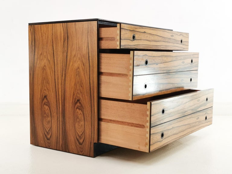 Staples chest of drawers  Offered for sale a rare chest of drawers by Staples & Co from the prestigious Deauville Range, circa 1960 the chest is made in a rich and detailed grained Rosewood with black trim. The unit has four drawers, and recessed