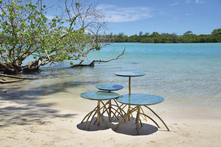 Designed by Francesco Maria Messina  Set of four low tables with green marble tops and legs in solid bronze hand casted from real mangrovia trees.  Naturae collection is an ode to the endemic nature of Mauritius. The pieces that are included in