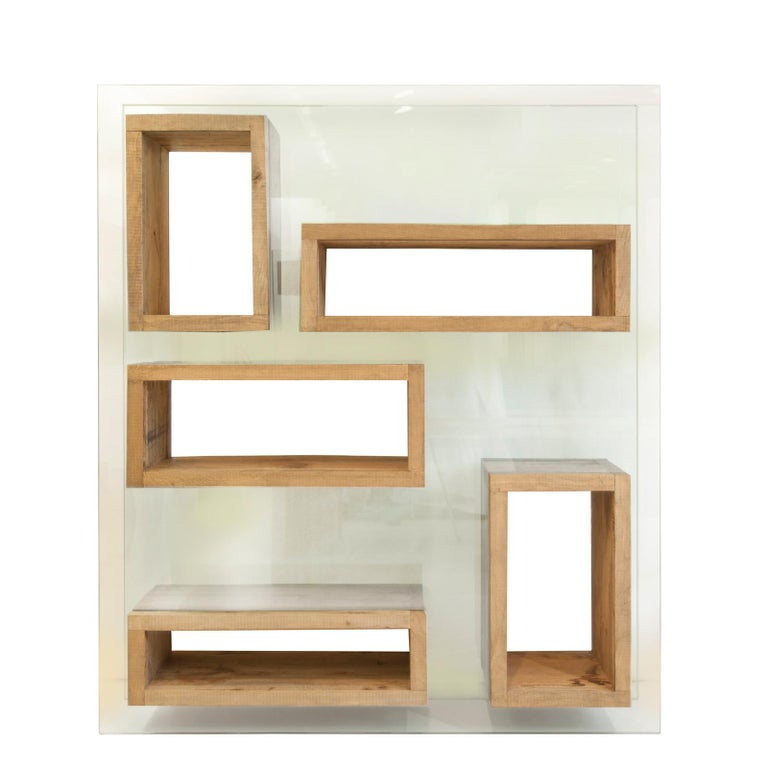 """Designed by Matteo Casalegno  """"Volumi Sospesi"""" is a beautiful bookcase made in antique wood and glass. It has pure and minimal, geometrical forms and can be used in 2 dimensions: in front and from a side.  Available in different size."""