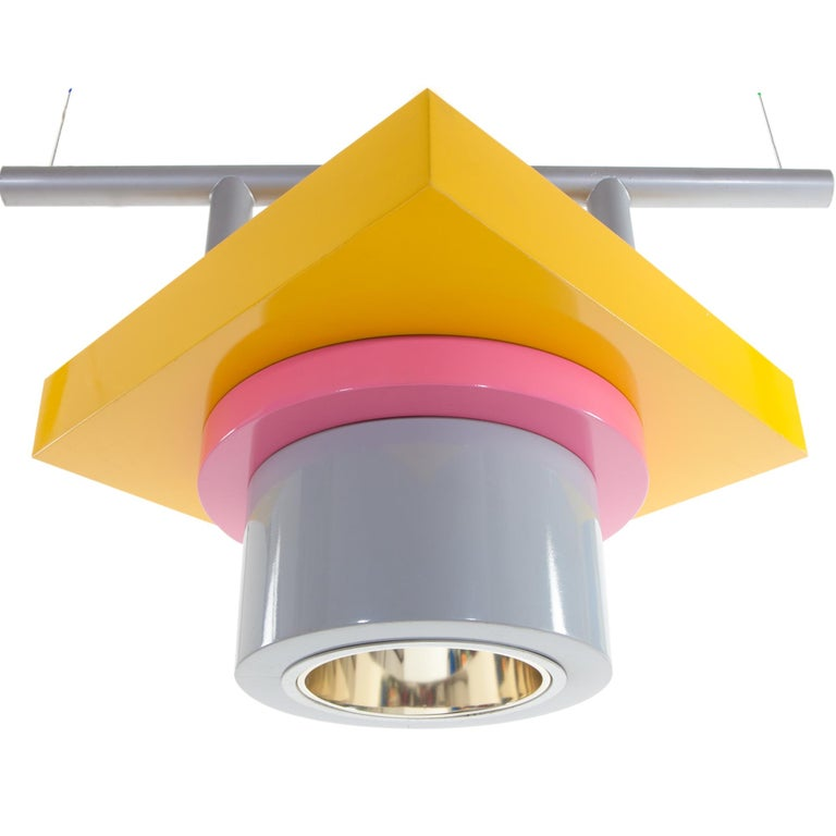 The lacquered metal Rossella Ceiling Lamp, with EU wiring accessibility, was designed by Marco Zanini in 1985 for Memphis Milano.  Marco Zanini was born in Trento in 1954. He graduated in architecture at the University of Florence and perfects his