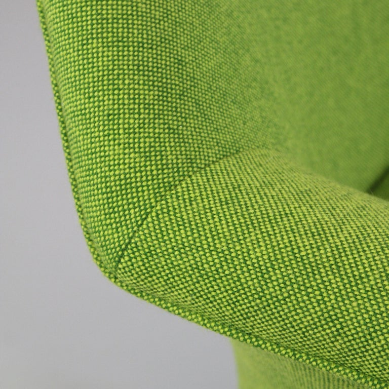 Armchair P32, designed by Osvaldo Borsani. Italy, Tecno, 1956.  Swivel armchair with automatic reopositioning mechanism. Rotating armchair on black metal frame and brass feet. New upholstery using green KVADRAT wool mix. Original manufacturers