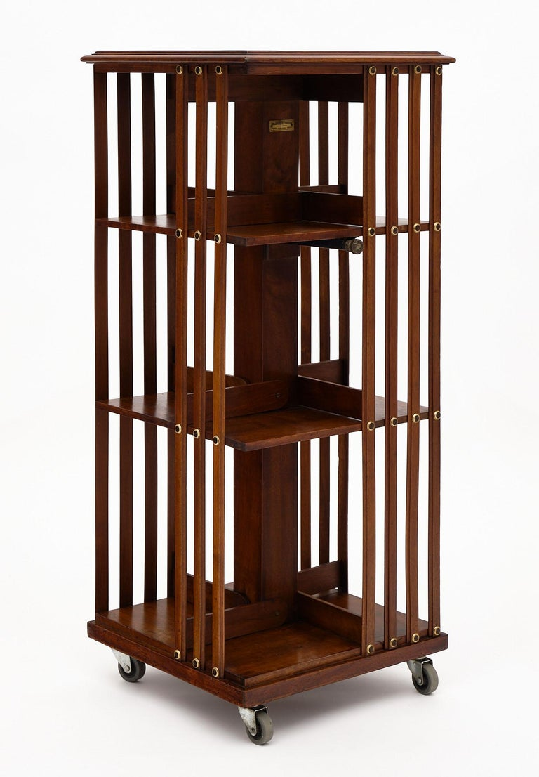 Rotating bookcase from France made of solid walnut on casters with three levels.