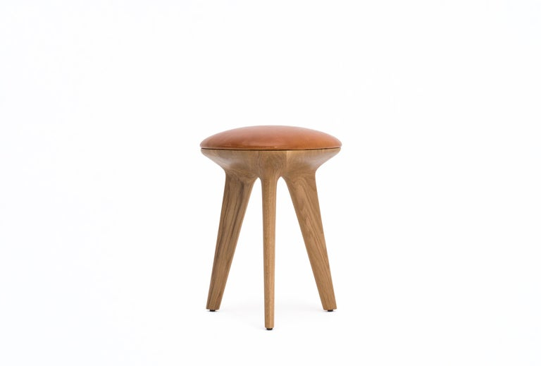 Inspired by the Reuleaux rotating triangle, the form of the Rotor stool is based on the intersection of three circles. The CNC-cut organic shape celebrates 'the curve of constant width'. Available as a comfortable stool in oak or ebonized oak with