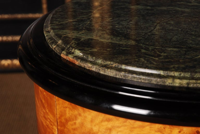 Maple roots on solid pinewood, partially ebonized.  Measures:  Height 80 cm,  diameter 54 cm.