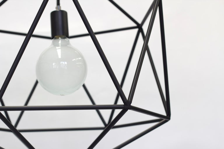 Rough diamond pendant is a decorative fixture that combines handmade craftsmanship with digital technology. The design combines a 3D printed joining system with handcut and assembled copper or brass tube. The result is a decorative feature light