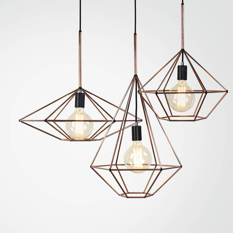 Rough diamond pendant is a decorative fixture that combines handmade craftsmanship with digital technology. The design combines a 3D printed joining system with hand cut and assembled copper or brass tube. The result is a decorative feature light