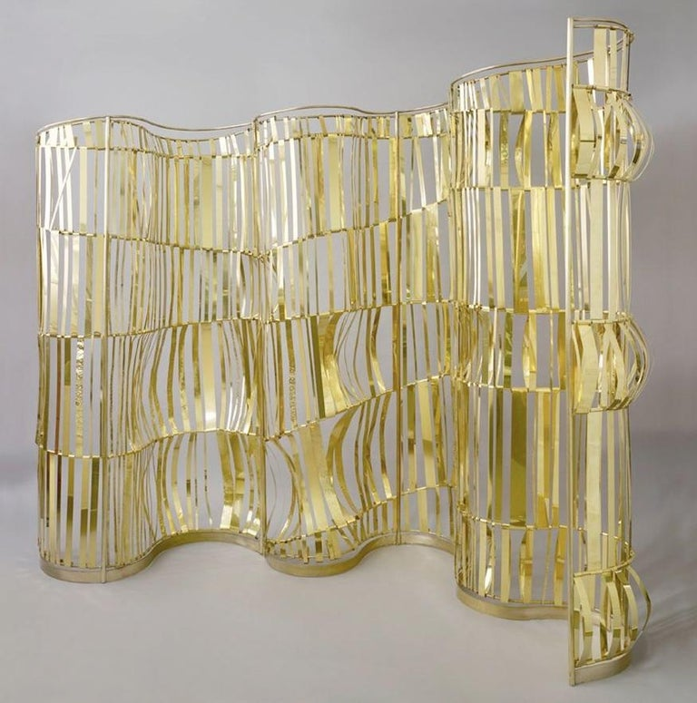 TAHER CHEMIRIK ROUGH SEA  2012  SCREEN – ROOM DIVIDER BRASS  Dimensions: H 90.5 X L 118 X W 19.5 INCHES  About the Artist Since 2012, jewelry artist Taher Chemirik has been designing furniture and lights for Galerie BSL that are like true jewels for