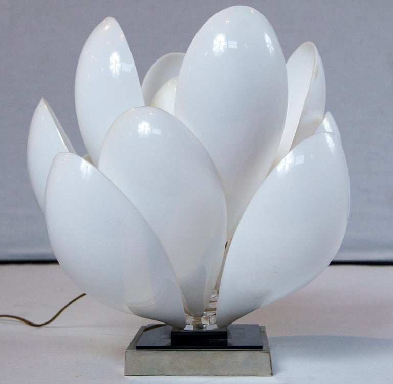 Roger Rougier Lucite lotus table lamp. A multiple Lucite leaf lotus flower with a center light bulb socket form this table lamp.