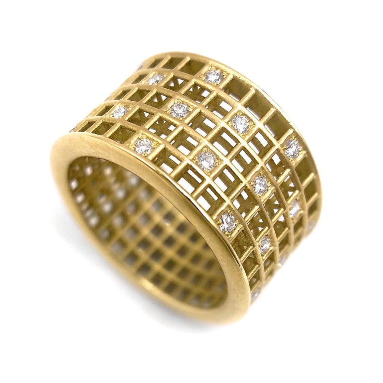 Five Row Pixel Dust Band intricately crafted in matte-finished 18k yellow gold with 0.47 total carats of round brilliant-cut white diamonds and accented with high-polished 18k yellow gold edges. Size 6.0. Stamped and Hallmarked.