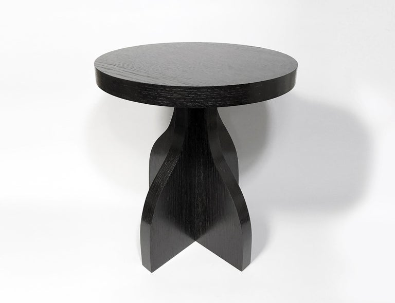The vase table is inspired by a modern, graphic take on cubism and gestural form. The base pulls its form from a curvy vase or vessel, then is abstracted and segmented into four unique profiles. The simple table surface is placed atop to complete