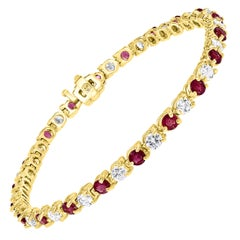 Round 2 Carat Diamond and 2 Carat Ruby Line Tennis Bracelet in Yellow Gold