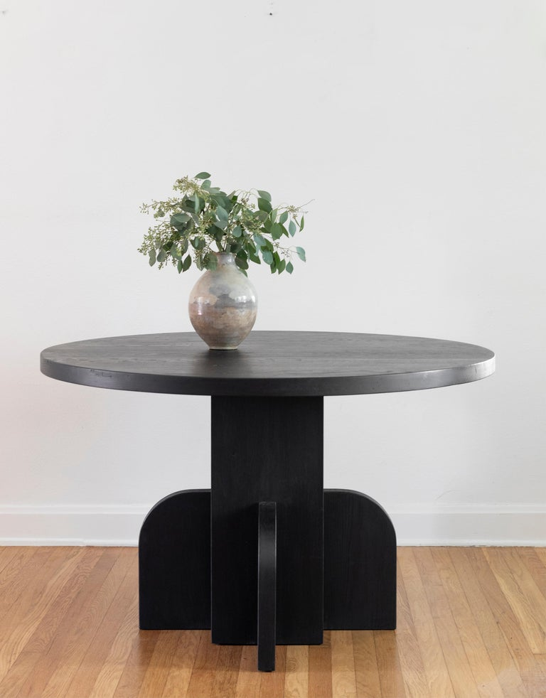 The Ratio dining table was designed by Scott Martin of the Austin-based Seer Studio. The designs are based on hand drawings by Scott Martin, loosely inspired by the feeling of 1940s French and 1970s Italian furniture design styles. Scott's bold