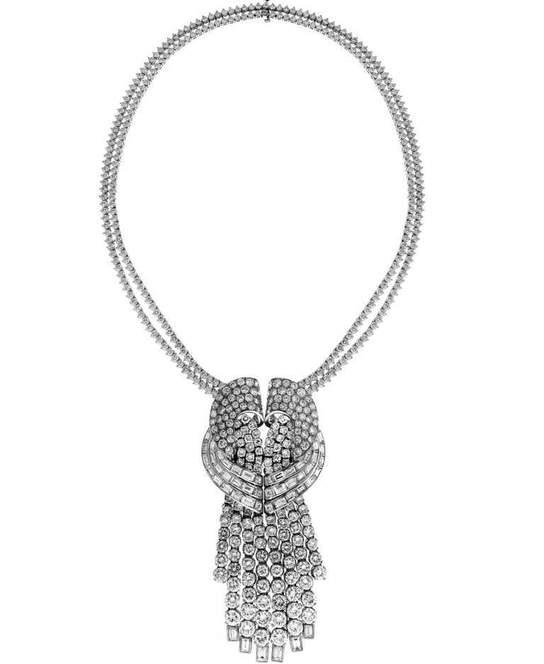 Platinum Pendant Necklace with Diamonds attached to Two Diamond Tennis Necklaces  Round and Straight Baguette Diamonds are set all throughout the pendant. Pendant is attached to two tennis necklaces.  Total weight of diamonds: Apprx. 53.81 carat all