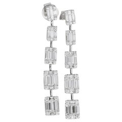 Round and Baguettes Dangling Drop Earrings in 18 Karat White Gold