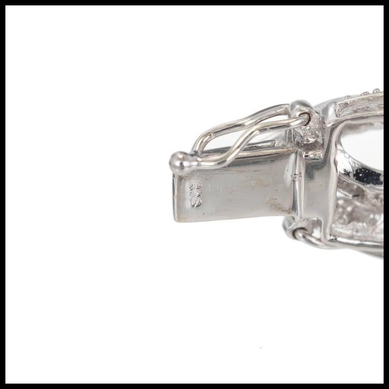 Round Cut Round Baguette Diamond Swirl Link Gold Bracelet For Sale