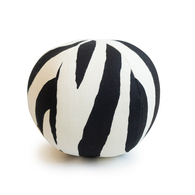 A handmade round ball throw pillow in a zebra print fabric. All pillows are hand sewn in our studio in Norwalk, Connecticut.   Measurements: 10