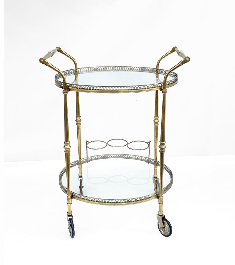 Maison Baguès superb two-level bar trolley. Made of high quality brass and bronze. With bottle holder.