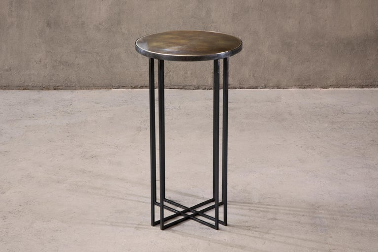 Side table in patinated brass. Brushed brass trim. Handcrafted in North East, England.  Measures: 40cm (diameter) x 70cm (height).  Custom sizes available.  Made to order in 12 weeks. Price excludes VAT.