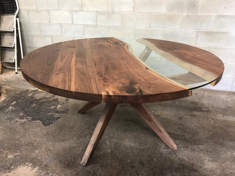 This round black walnut dining table on black walnut legs is the perfect nook table. It sits comfortably 4-5 people for a 66in diameter and more depending on the size. Each table is different because of the live edge of the slabs. We use tempered