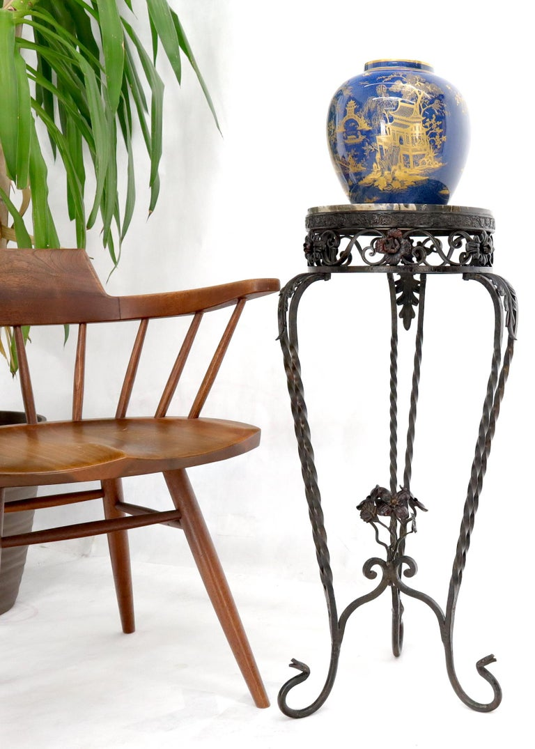 Decorative wrought iron marble top pedestal stand. Marble top diameter is 11