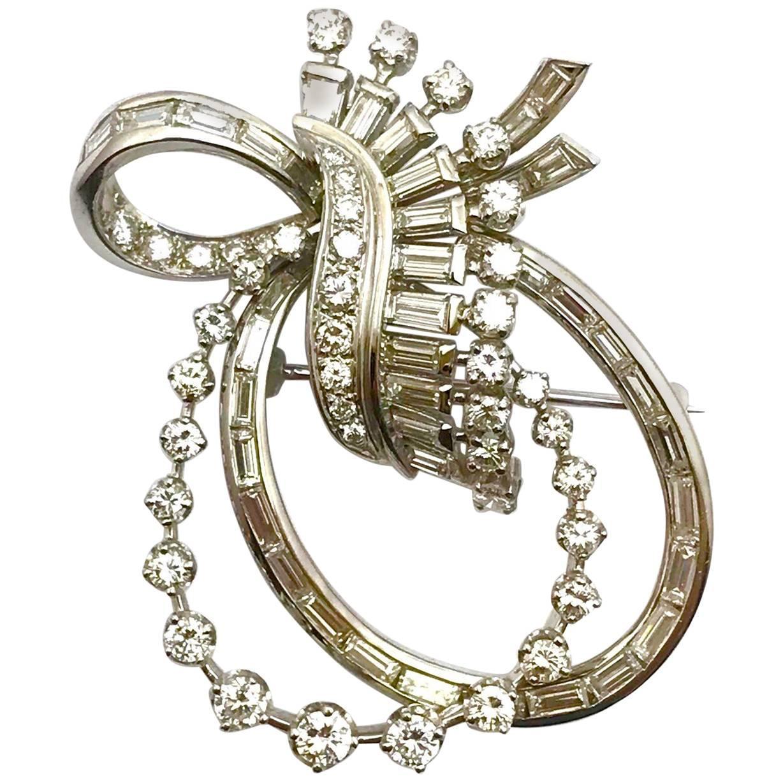 Round Brilliant and Baguette Diamond Platinum Double Bow Pendant Brooch